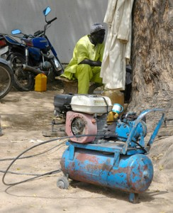 Kano bike repair shop's small diesel powered air compressor.